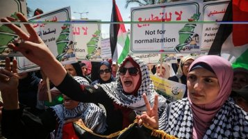 Palestinians-gather-to-protest-against-a-deal-between-the-UAE-and-Israel-to-normalise-ties-in-...jpg
